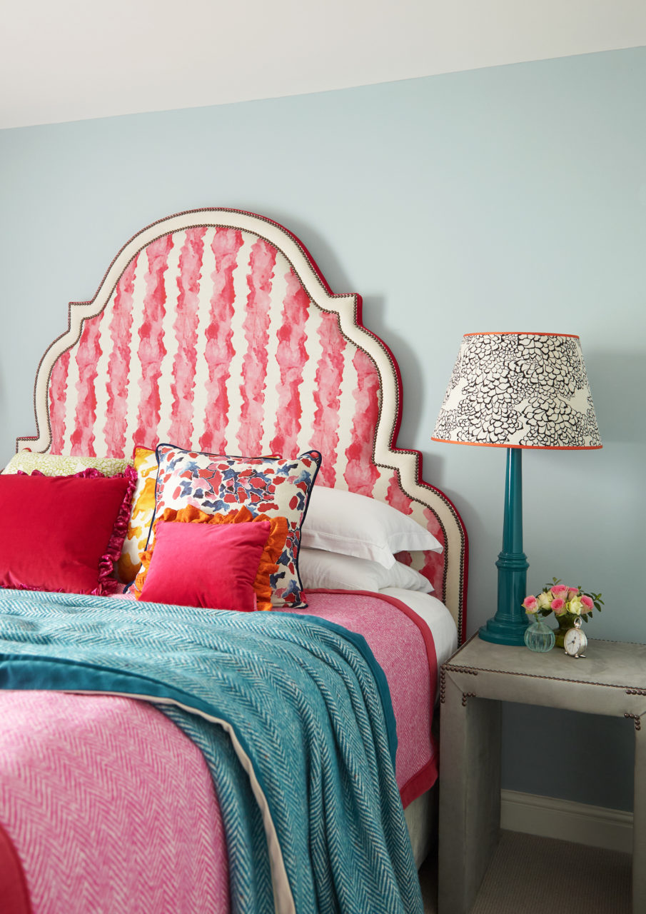 Beautiful upholsted decorative headboard on a bed""
