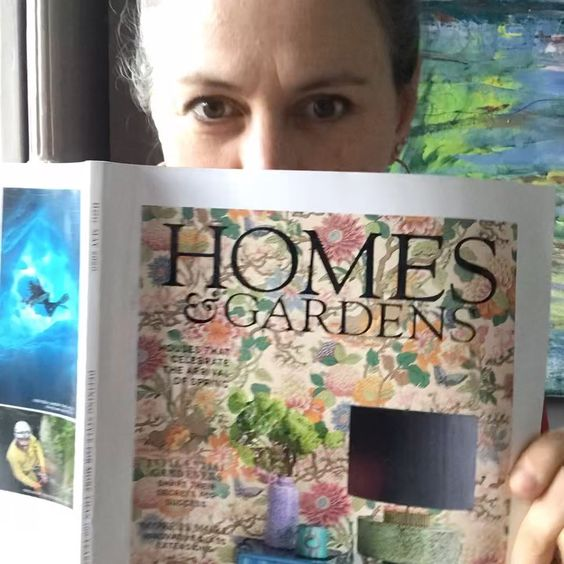 We love interiors magazines! Stylist Emma Morton Turner holding Homes and Garden magazine.