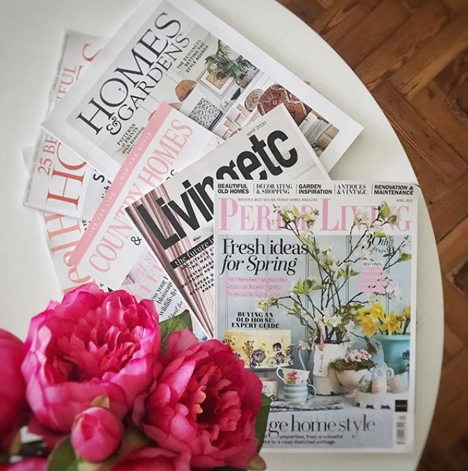 We love interior magazines! Interior lifestyle shot of a living room table with magazines.