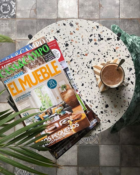 We love interior magazines! Round stone table with magazines.
