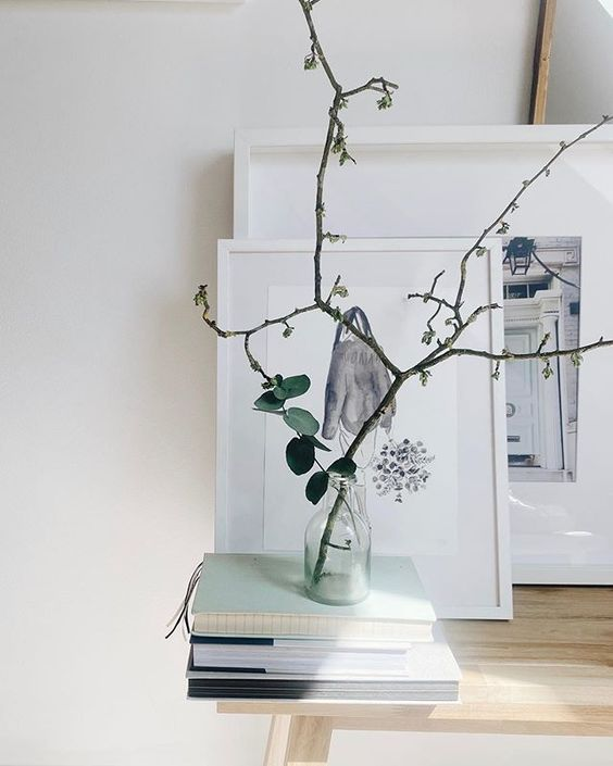 Styling foraged finds from a walk using delicate branches