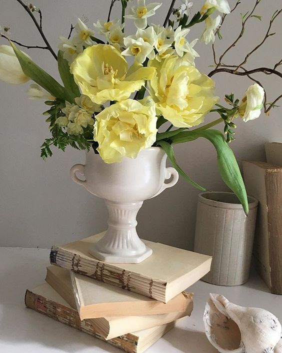 Styling foraged finds from a walk using yellow flowers
