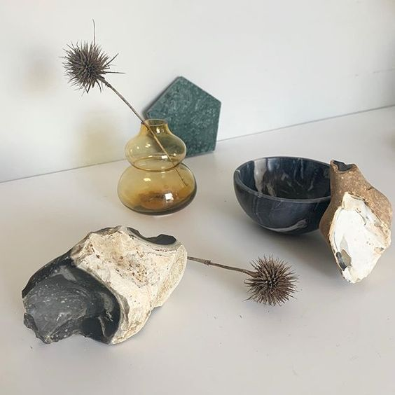 Styling foraged finds from a walk. Thistle heads in a yellow glass vase