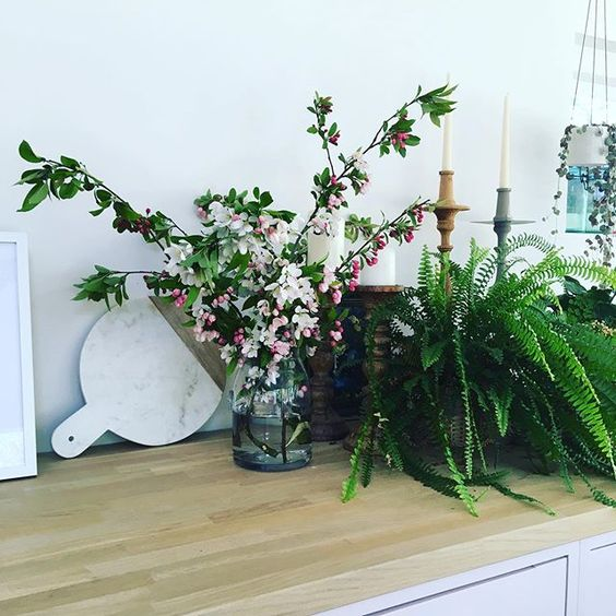 Styling foraged finds from a walk. Marble chopping board styled behind some blossom branches