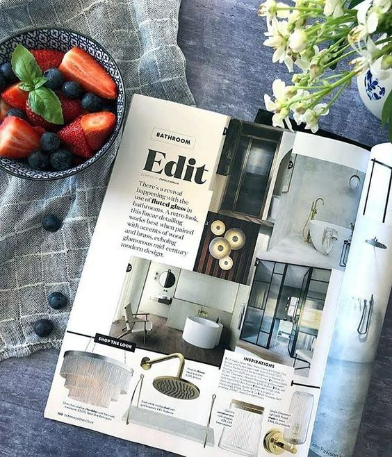 We love interiors magazines! Lifestyle flat lay of interior magazines and some strawberries.