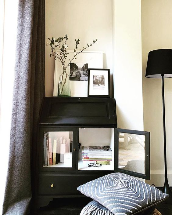 We love Interiors Magazines! Black dresser with magazines in.
