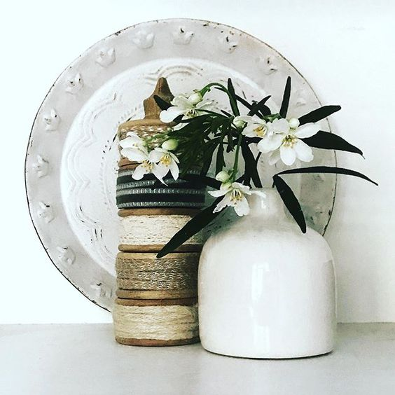 Styling foraged finds from a walk. A collections of vases with flowers