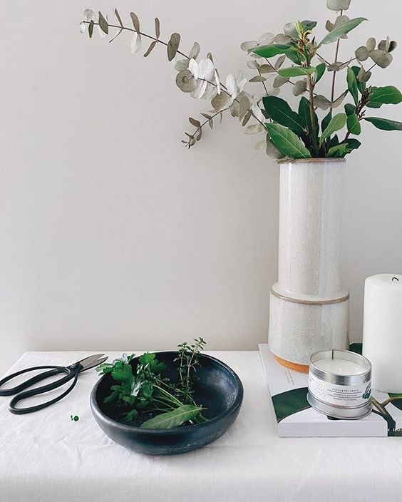 Styling foraged finds from a walk. Lifestyle image of flowers in a vase ad some gardening scissors