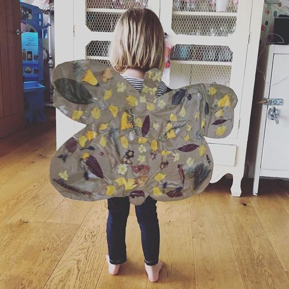 Styling foraged finds from a walk. A pair of butterfly wings made and worn by a child.