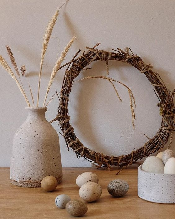 Styling foraged finds from a walk. A collection of eggs and a twig wreath.