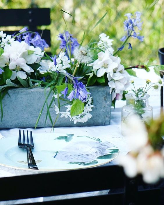Styling foraged finds from a walk. Lifestyle image of a table setting with flowers.