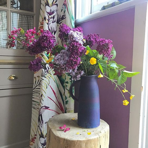 Styling foraged finds, gorgeous purple flowers in a purple vase.