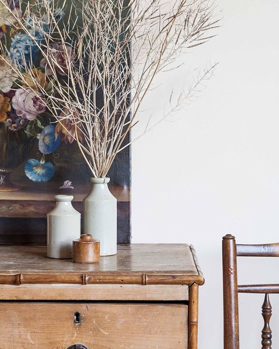 How to use colour in a room. Floral artwork styled behind 3 vases and styled branches