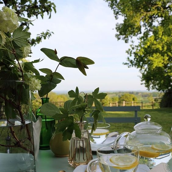 The secret styling tip for adding personality to your home that you need to know! Lifestyle shot of a table styled with drinks outside in the English countryside