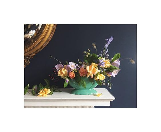 The secret styling tip for adding personality to your home that you need to know! Interiors vignette of a collection of colourful flowers on a mantlepiece