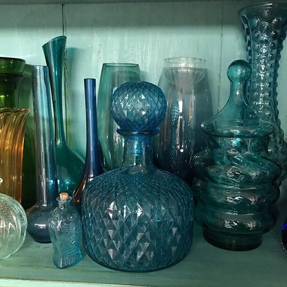 How to use colour in a room. Collection of colourful blue glassware