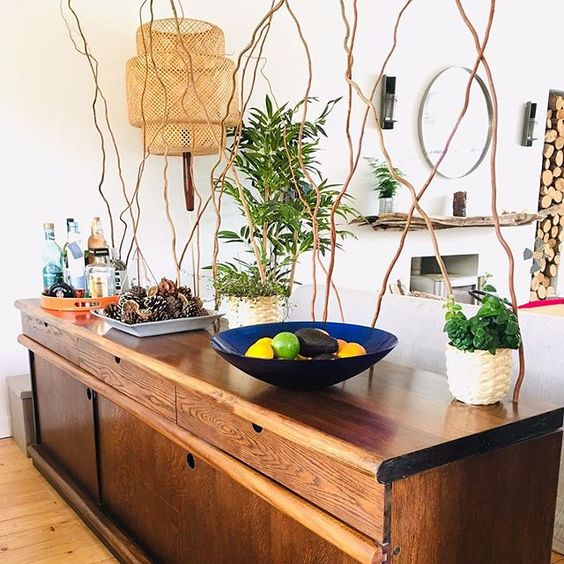 20 of the best vintage interiors in the UK. Vintage sideboard styled with vintage bowl and vases