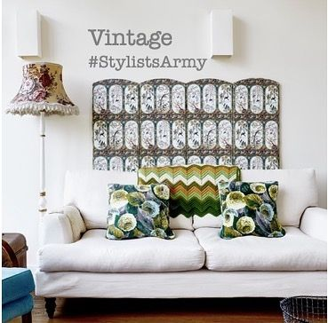 20 of the best vintage interiors in the UK. Vintage lamp and pillows on a white sofa