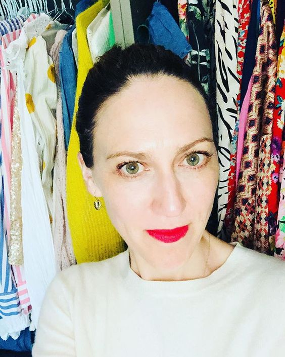 How to use colour in a room. Selfie of a woman wearing bold red lipstick