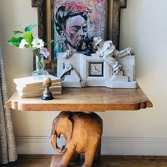20 of the best vintage interiors in the UK. Vintage picture table styled with vintage frames