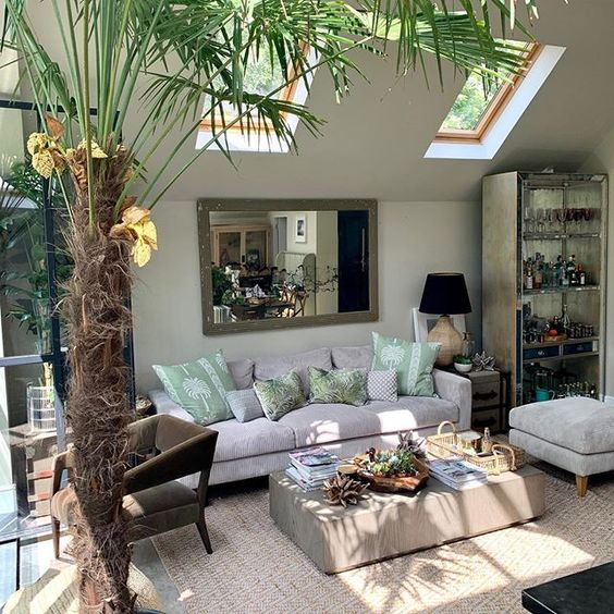 How to use colour in your home. Sunny garden room featuring a colourful palm tree inside