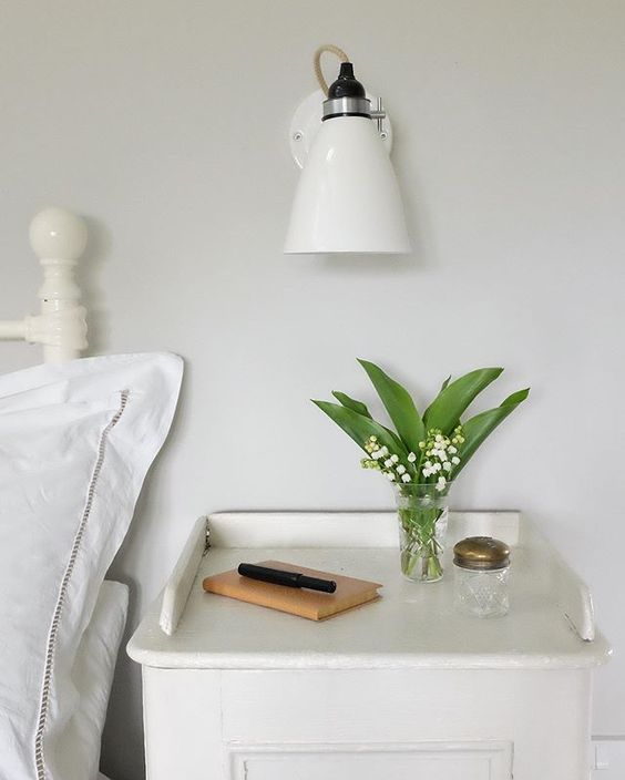 20 of the best vintage interiors in the UK. White bedroom with vintage accessories