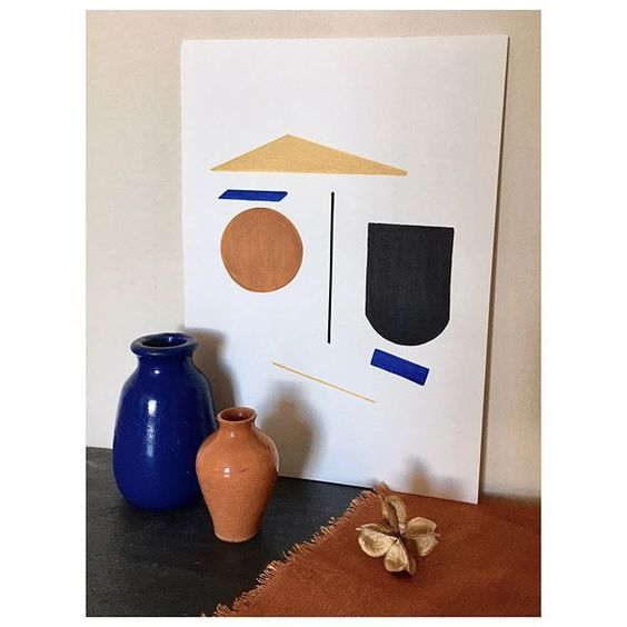 How to use colour in a room. Colourful abstract artwork styled with small pottery vases