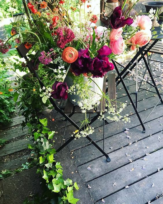 The secret styling tip for adding personality to your home that you need to know! Beautiful flowers styled on an outdoor dining chair