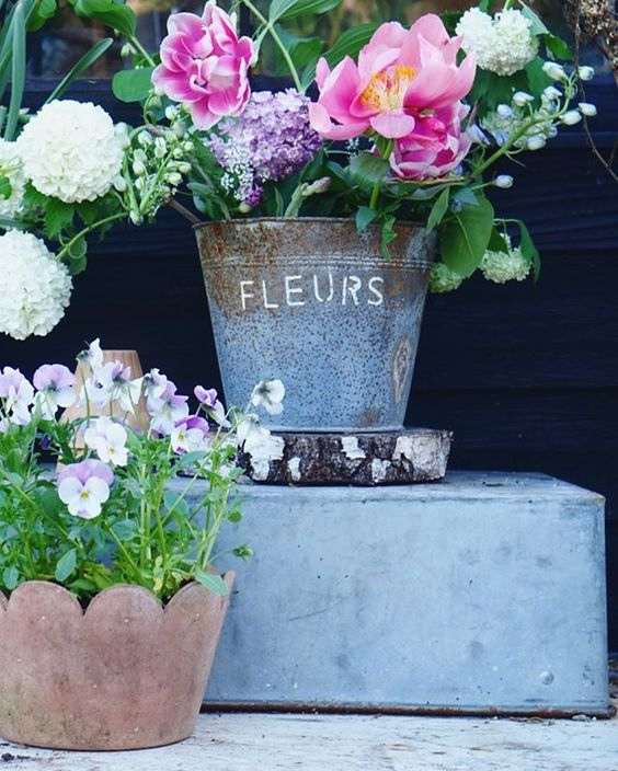 How to use colour in a room. Beautiful garden flowers styled in an antique French bucket