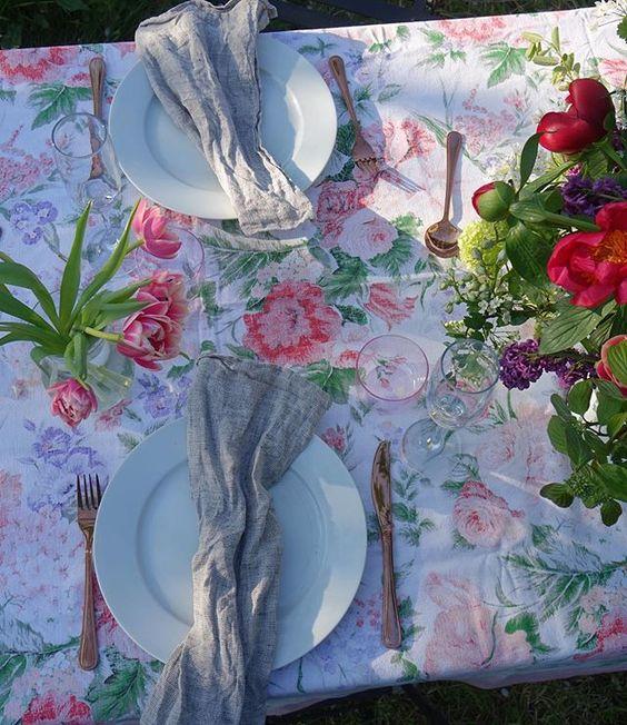 20 of the best vintage interiors in the UK. Vintage flowered tablecloth and cutlery