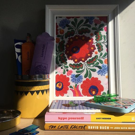 How to use colour in a room. Colourful floral print styled with some colourful books