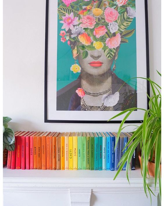 How to use colour in a room. Books organised by colour underneath a print of Frida Kahlo