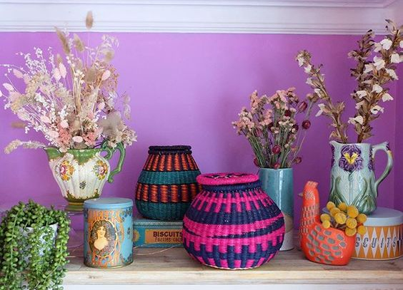 The secret styling tip for adding personality to your home that you need to know! Colourful baskets in front of a purple wall