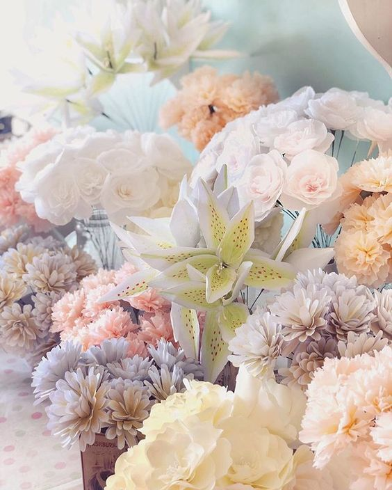 19 creative ways to use paper.Handmade paper flowers for a wedding.