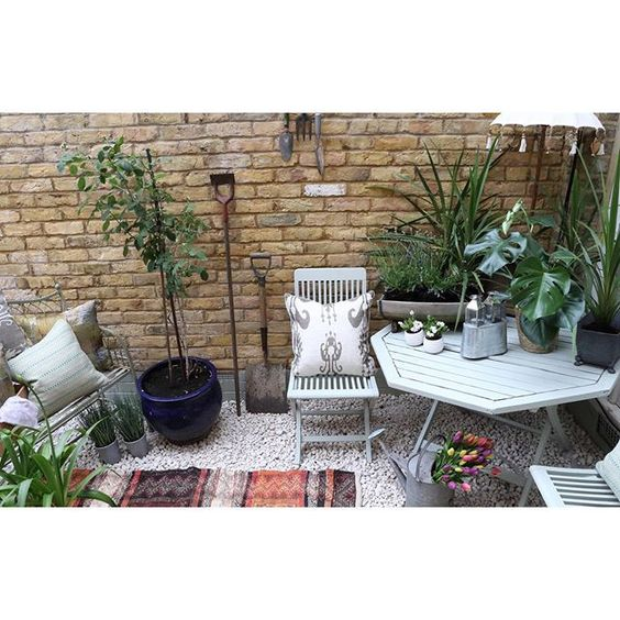 Garden style ideas from UK interior stylists. How to style with plants and outdoor furniture.