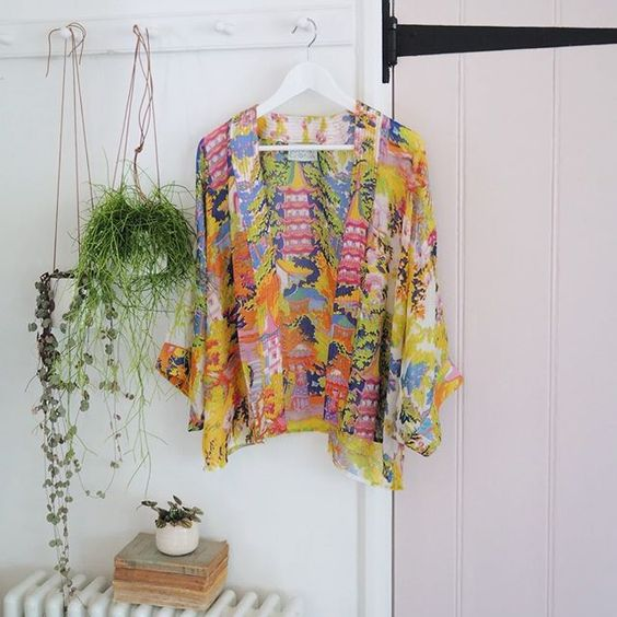 How to stay positive online in 2020. Brightly coloured shirt hanging next to a pink door.