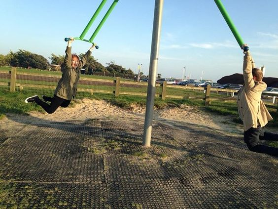 How to stay positive online in 2020. Man and a woman on a child's swing.