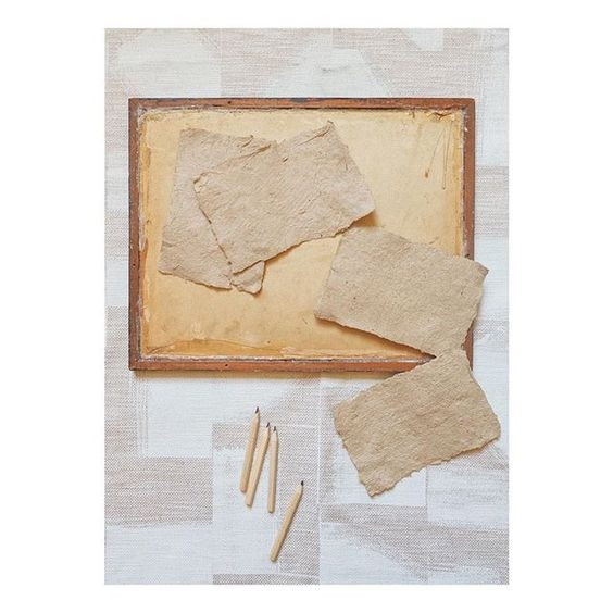 19 creative ways to use paper.Flat lay of assorted paper in muted tones.