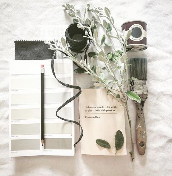 19 creative ways to use paper.Flat lay of interior design art materials, including a paint brush, paint swatches, flower and Farrow and Ball tester paint.