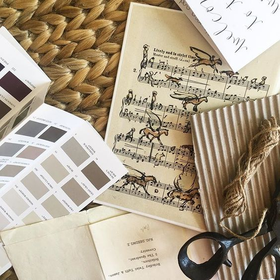 19 creative ways to use paper. Flat lay of paper products and paint swatches in muted tones.