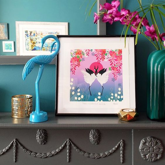 19 creative ways to use paper. Colourful framed print in front of a teal wall