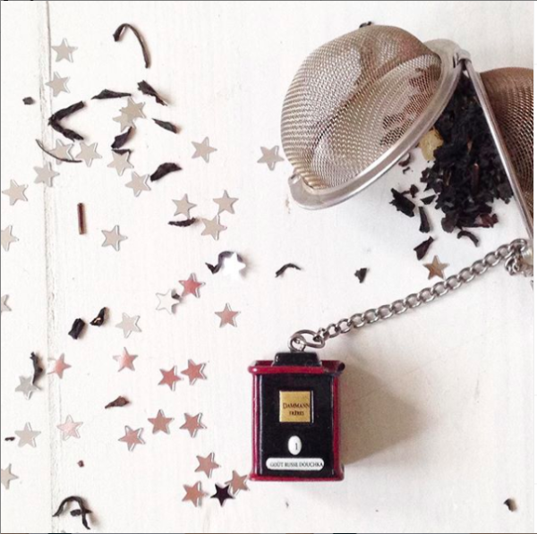 Styling shot of some loose leaf tea and small stars