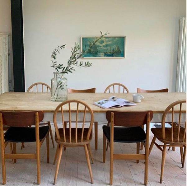 Lifestyle image of a wooden dining table and chairs