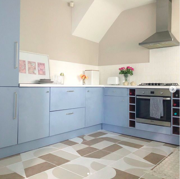 Kitchen with baby blue cupboard doors