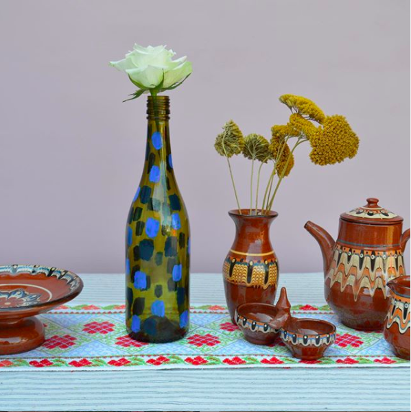 My Happy Place. Styled vases and jugs on a blue tablecloth.